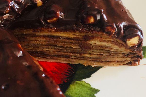 Recette Gâteau de crêpes glaçage chocolat/noisettes