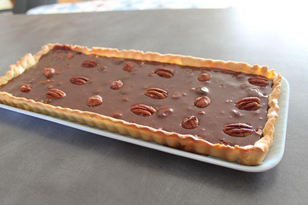Recette Tarte au chocolat au lait, caramel,noisettes et noix de pecan